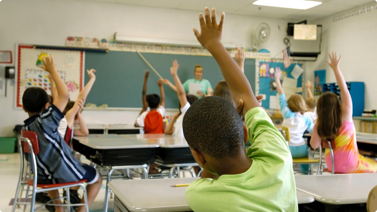 Kids Raising Hands in Classroom
